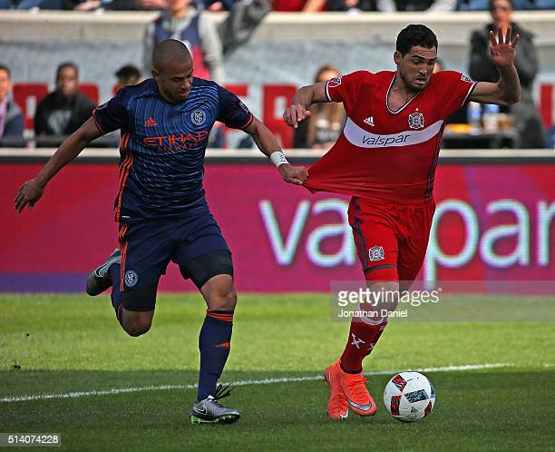 Jason Hernandez of New York City FC pulls on the jersey of Gilberto of Chicago Fire at Toyota Park on March 6 2016 in Bridgeview Illinois The New...