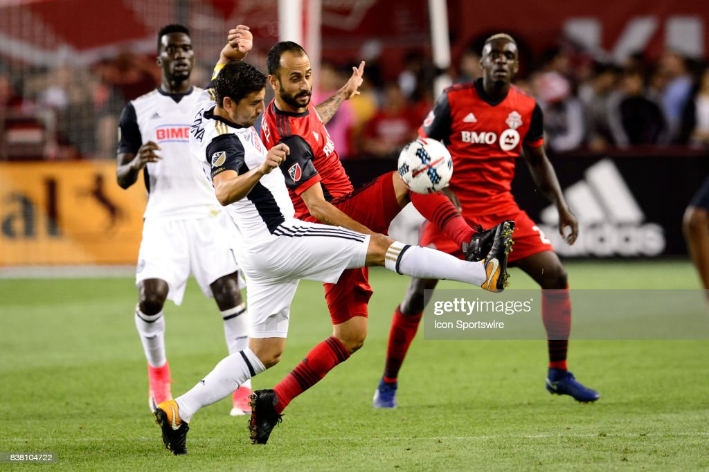 Jason Hernandez (12) of Toronto FC and Alejandro Bedoya (11) of Philadelphia Union battle for the ball during the second half of the MLS Soccer regular season game between Toronto FC and Philadelphia Union on August 23, 2017, at BMO Field in Toronto, ON, Canada.