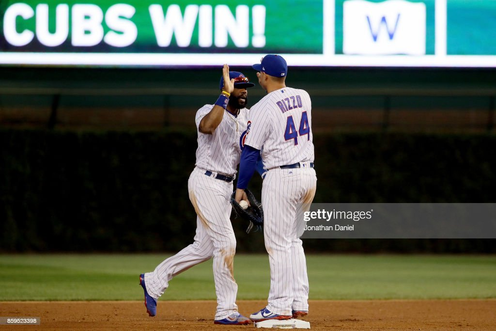 Jason Heyward #22 and Anthony Rizzo #44 of the Chicago Cubs celebrate after beating the Washington Nationals 2-1 in game three of the National League Division Series at Wrigley Field on October 9, 2017 in Chicago, Illinois.