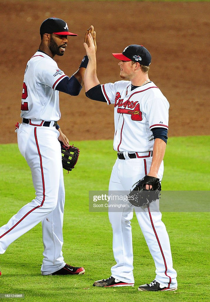 Jason Heyward #22 and Craig Kimbrel #46 of the Atlanta Braves celebrate after defeating the Los Angeles Dodgers during Game Two of the National League Division Series at Turner Field on October 4, 2013 in Atlanta, Georgia.
