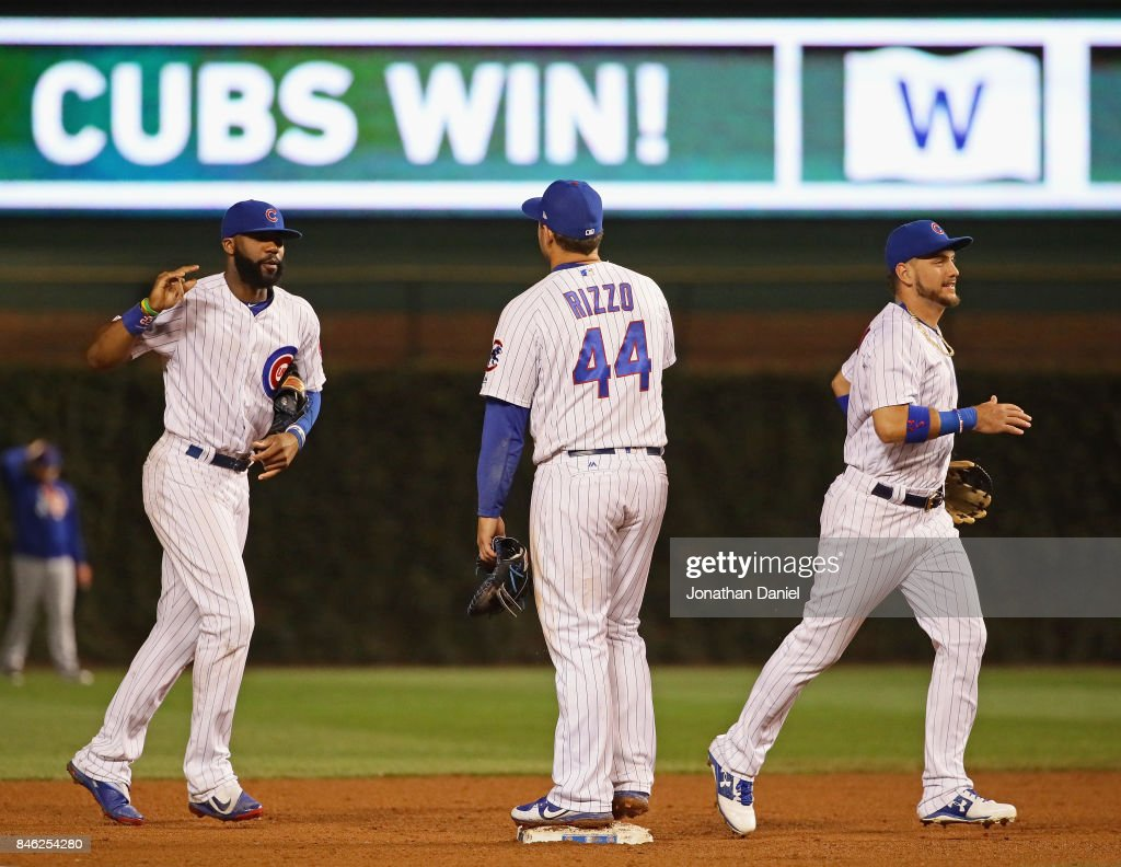 Jason Heyward #22, Anthony Rizzo #44 and Albert Almora Jr. #5 of the Chicago Cubs celebrate a win over the New York Mets at Wrigley Field on September 12, 2017 in Chicago, Illinois. The Cubs defeated the Mets 8-3.