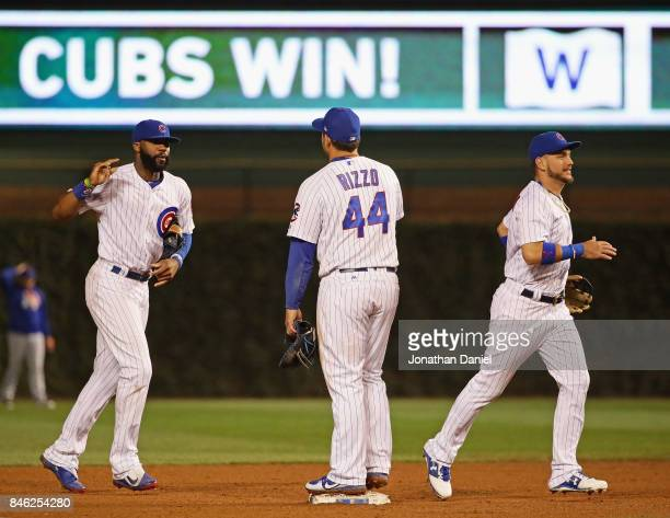 Jason Heyward Anthony Rizzo and Albert Almora Jr #5 of the Chicago Cubs celebrate a win over the New York Mets at Wrigley Field on September 12 2017...