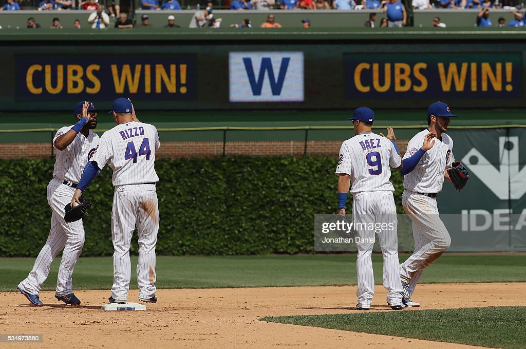 Jason Heyward #22, Anthony Rizzo #44, Javier Baez #9 and Kris Bryant #17 of the Chicago Cubs celebrate a win over the Philadelphia Phillies at Wrigley Field on May 28, 2016 in Chicago, Illinois. The Cubs defeated the Phillies 4-1.