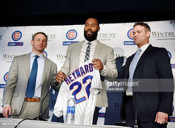 Jason Heyward gets his jersey during an introduction press conference as Chicago Cubs President Theo Epstein and general manager Jed Hoyer look on...