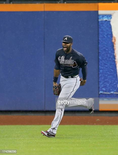 Jason Heyward of the Atlanta Braves celebrates after he made the catch for the final out of the game against the New York Mets on July 22 2013 at...