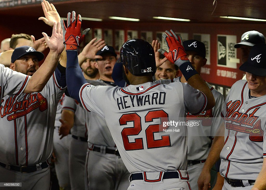 Jason Heyward #22 of the Atlanta Braves celebrates with teammates after hitting a 10th inning home run against the Arizona Diamondbacks at Chase Field on June 7, 2014 in Phoenix, Arizona.