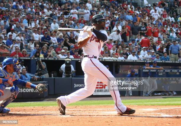 Jason Heyward of the Atlanta Braves hits a 3 run home run against the Chicago Cubs during Opening Day at Turner Field on April 5 2010 in Atlanta...