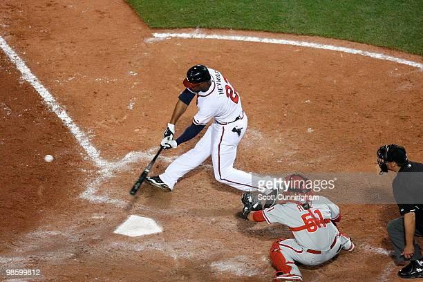Jason Heyward of the Atlanta Braves hits against the Philadelphia Phillies at Turner Field on April 21 2010 in Atlanta Georgia The Phillies defeated...