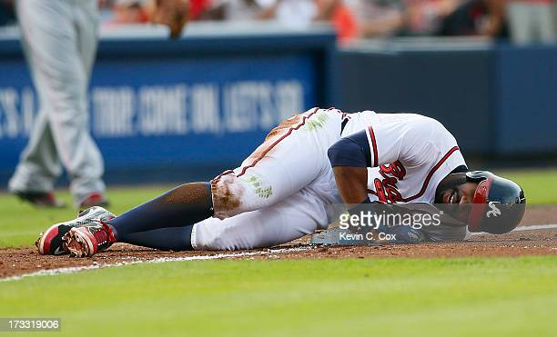 Jason Heyward of the Atlanta Braves injures himself as he slides into third base in the second inning against the Cincinnati Reds at Turner Field on...
