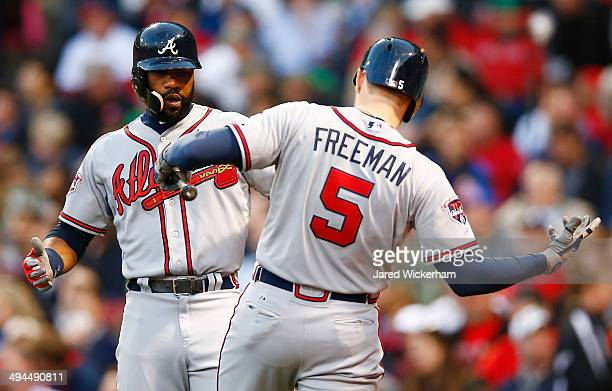 Jason Heyward of the Atlanta Braves is congratulated by teammate Freddie Freeman after hitting a solo home run in the third inning against the Boston...