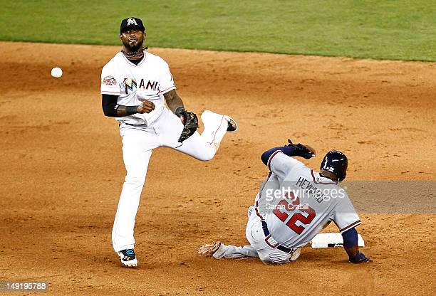 Jason Heyward of the Atlanta Braves is forced out at second by Jose Reyes of the Miami Marlins during a game at Marlins Park on July 24 2012 in Miami...