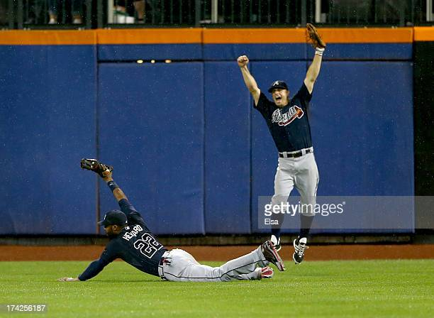 Jason Heyward of the Atlanta Braves makes the catch for the final out of the game as teammate Reed Johnson celebrates on July 22 2013 at Citi Field...