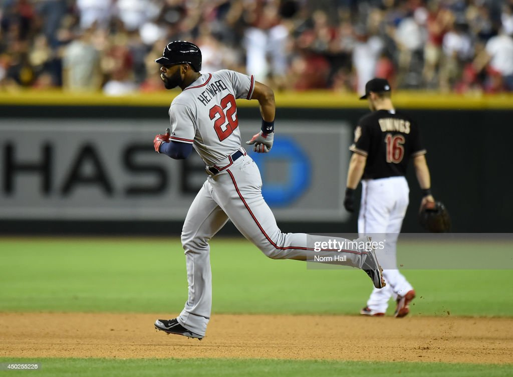 Jason Heyward #22 of the Atlanta Braves rounds the bases after hitting a 10th inning home run against the Arizona Diamondbacks at Chase Field on June 7, 2014 in Phoenix, Arizona.