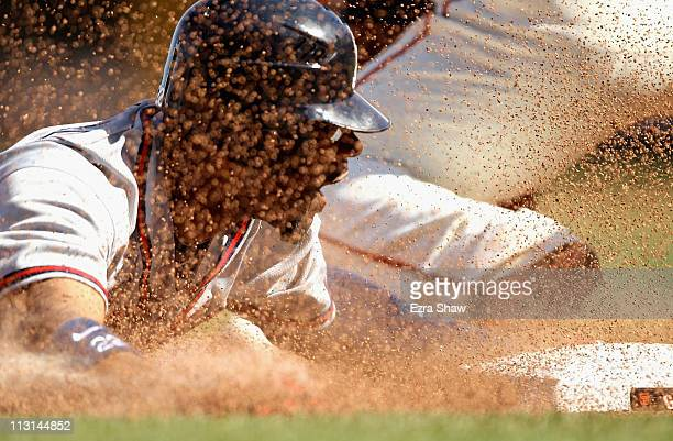 Jason Heyward of the Atlanta Braves safely slides in to third base during the 10th inning of their game against the San Francisco Giants at ATT Park...