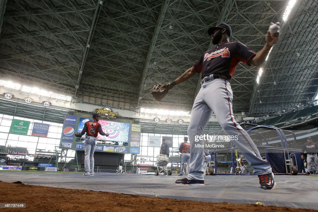 Jason Heyward #22 of the Atlanta Braves warms up before the game against the Milwaukee Brewers during Opening Day at Miller Park on March 31, 2014 in Milwaukee, Wisconsin.
