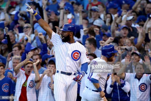 Jason Heyward of the Chicago Cubs celebrates after Albert Almora Jr hit a double in the seventh inning against the Washington Nationals during game...