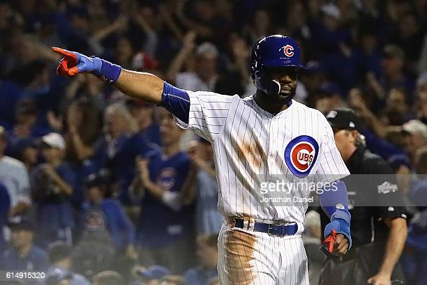 Jason Heyward of the Chicago Cubs celebrates after scoring a run in the second inning against the Los Angeles Dodgers during game one of the National...