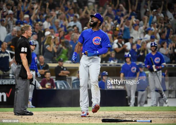 Jason Heyward of the Chicago Cubs celebrates as he scores during the ninth inning of a baseball game against the San Diego Padres at PETCO Park on...