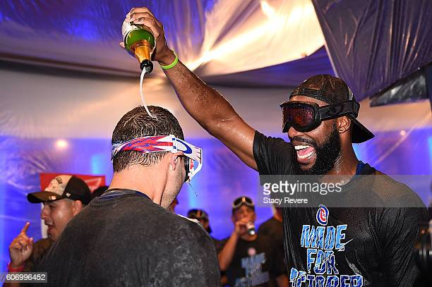 Jason Heyward of the Chicago Cubs celebrates in the locker room following a victory over the Milwaukee Brewers at Wrigley Field on September 16 2016...