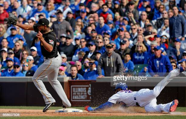 Jason Heyward of the Chicago Cubs dives for a single as Felipe Rivero of the Pittsburgh Pirates is unable to make the catch in time during the eighth...