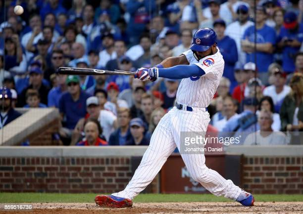 Jason Heyward of the Chicago Cubs hits a single in the seventh inning against the Washington Nationals during game three of the National League...