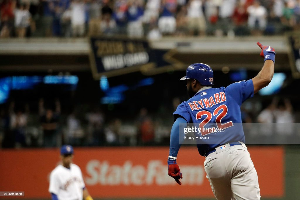 Jason Heyward #22 of the Chicago Cubs hits a solo home run during the eleventh inning of a game against the Milwaukee Brewers at Miller Park on July 29, 2017 in Milwaukee, Wisconsin.