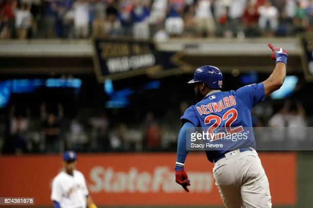 Jason Heyward of the Chicago Cubs hits a solo home run during the eleventh inning of a game against the Milwaukee Brewers at Miller Park on July 29...