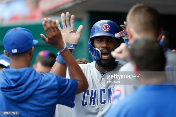 Jason Heyward of the Chicago Cubs is congratulated by his teammates after scoring a run during the fifth inning of the game against the Cincinnati...