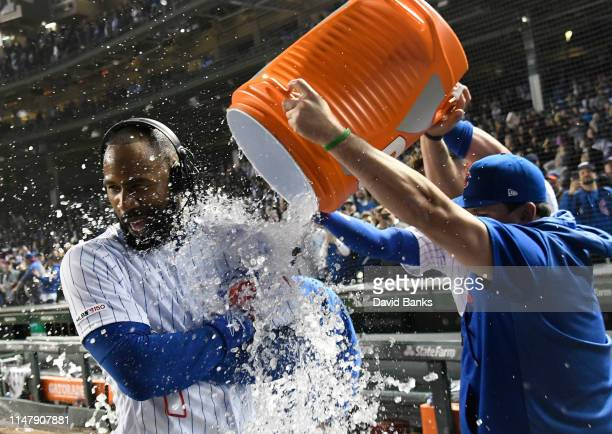 Jason Heyward of the Chicago Cubs is doused with liquid after hitting a game winning home run against the Miami Marlins during the eleventh inning at...