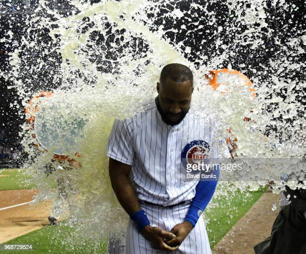 Jason Heyward of the Chicago Cubs is doused with sports drink after hitting a walkoff grand slam home run against the Philadelphia Phillies during...