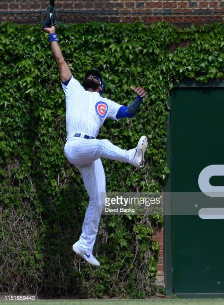 Jason Heyward of the Chicago Cubs makes a catch on Eugenio Suarez of the Cincinnati Reds during the seventh inning at Wrigley Field on May 25, 2019...