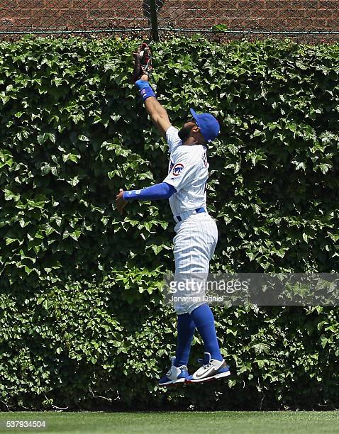 Jason Heyward of the Chicago Cubs makes a leaping catch on a ball hit by Jake Lamb of the Arizona Diamondbacks in the 2nd inning at Wrigley Field on...