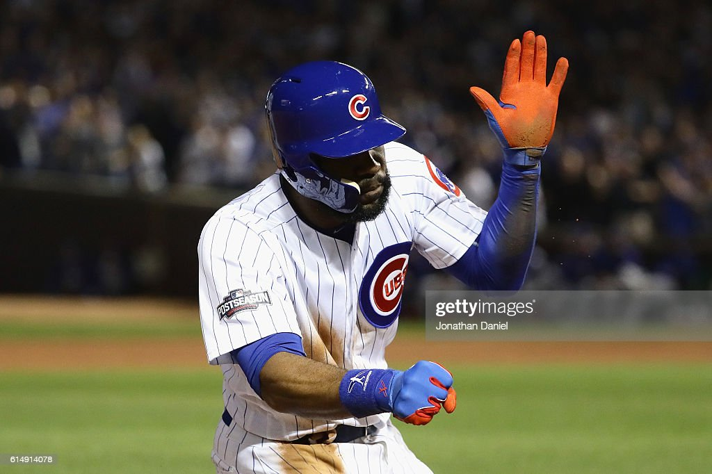 Jason Heyward #22 of the Chicago Cubs reacts after hitting a triple in the second inning against the Los Angeles Dodgers during game one of the National League Championship Series at Wrigley Field on October 15, 2016 in Chicago, Illinois.
