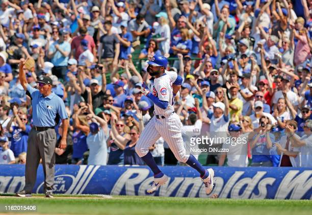Jason Heyward of the Chicago Cubs rounds the bases following his two run home run during the fifth inning against the Pittsburgh Pirates at Wrigley...