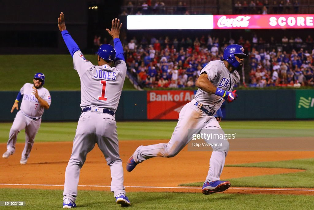 Jason Heyward #22 of the Chicago Cubs rounds third base on his way to scoring a run against the St. Louis Cardinals in the seventh inning at Busch Stadium on September 27, 2017 in St. Louis, Missouri.