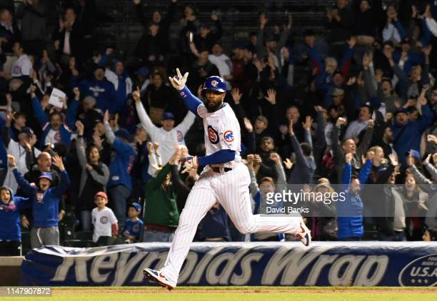 Jason Heyward of the Chicago Cubs runs the bases after hitting a game winning home run against the Miami Marlins during the eleventh inning at...