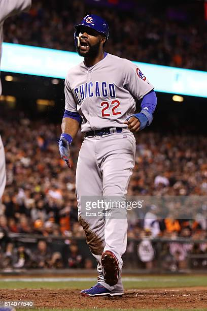 Jason Heyward of the Chicago Cubs scores the go ahead run on a RBI single by Javier Baez in the eighth inning of Game Four of their National League...