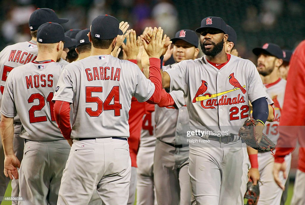 Jason Heyward #22 of the St Louis Cardinals is congratulated by Jaime Garcia #54 and teammates after a 3-1 victory against the Arizona Diamondbacks during a MLB game at Chase Field on August 26, 2015 in Phoenix, Arizona.