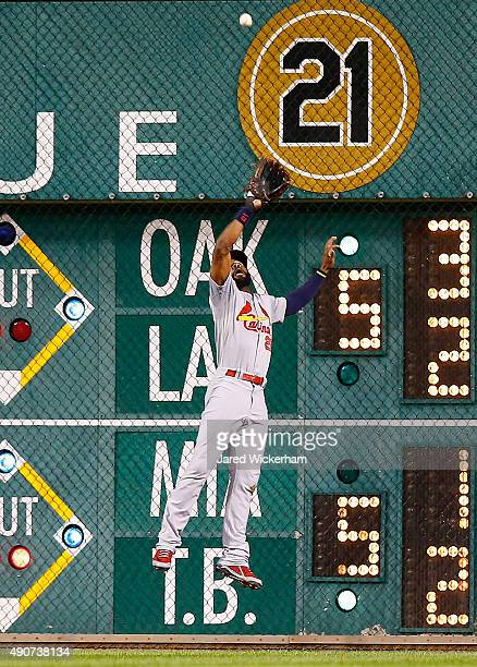 Jason Heyward of the St Louis Cardinals makes a catch along the right field wall against the Pittsburgh Pirates during the game at PNC Park on...