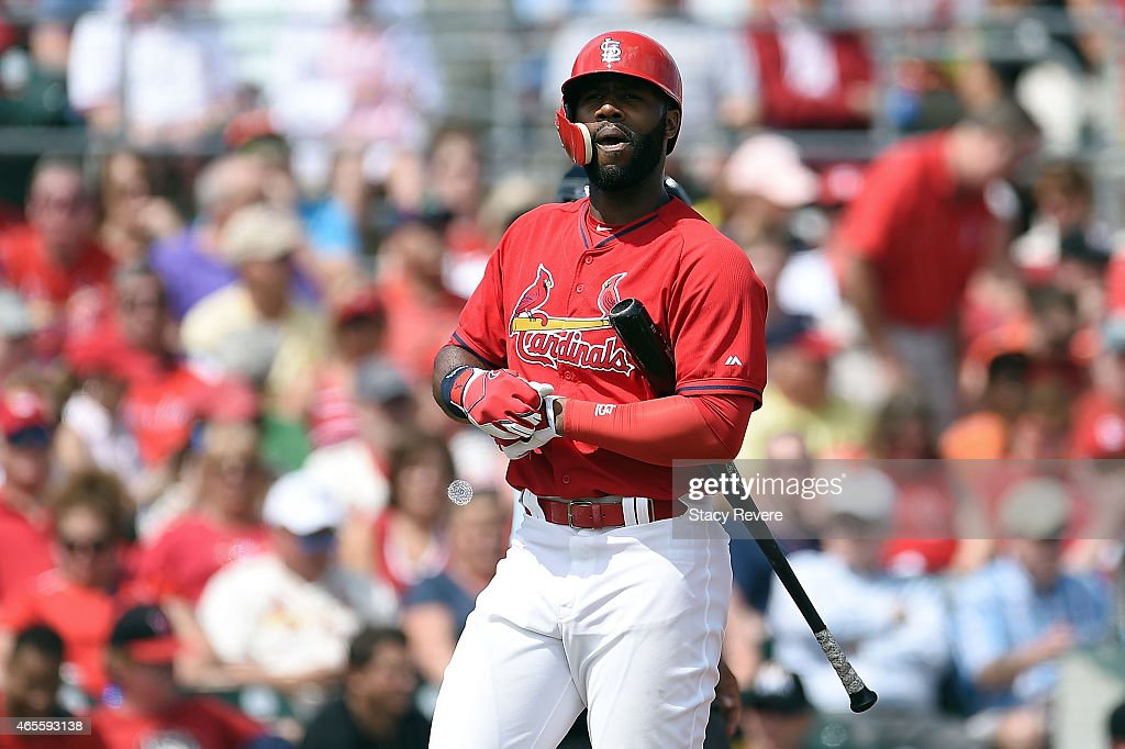 Jason Heyward #22 of the St. Louis Cardinals reacts to a strike out during the first inning of a spring training game against the Miami Marlins at Roger Dean Stadium on March 8, 2015 in Jupiter, Florida.