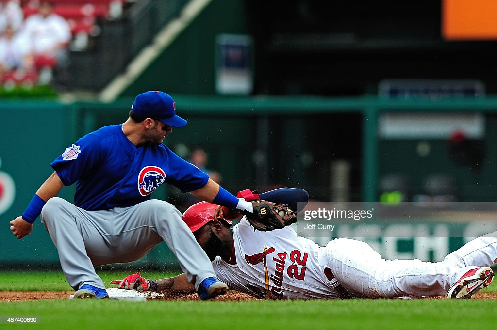 Jason Heyward #22 of the St. Louis Cardinals slides safely past the tag of Tommy La Stella #11 of the Chicago Cubs for a stolen base during the first inning at Busch Stadium on September 9, 2015 in St. Louis, Missouri.