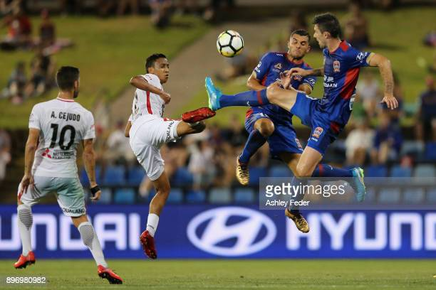 Jason Hoffman and Andrew Nabbout of the Jets contest the ball against the Western Sydney Wanderers defence during the round 12 ALeague match between...