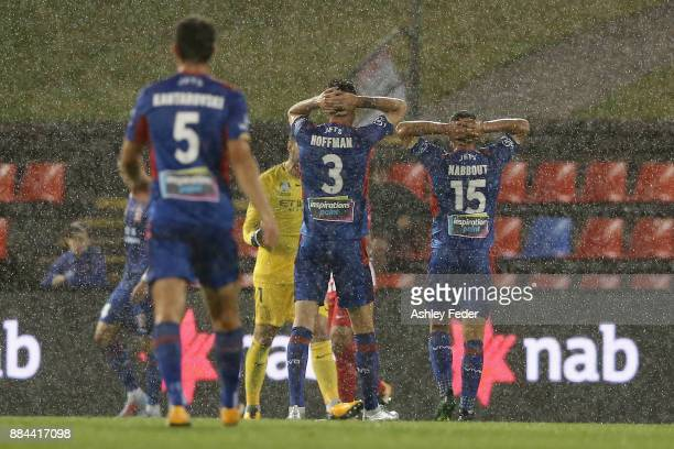 Jason Hoffman and Andrew Nabbout of the Jets react to a Melbourne City goal and during the round nine ALeague match between the Newcastle Jets and...