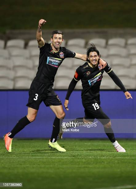 Jason Hoffman and Kosta Petratos of the Jets celebrate Petratos scoring a goal during the round 28 A-League match between Sydney FC and Newcastle...