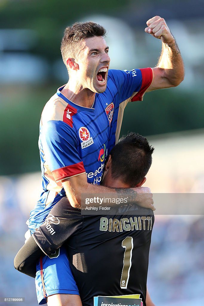 Jason Hoffman and Mark Birighitti of the Jets celebrates the win during the round 21 A-League match between the Central Coast Mariners and the Newcastle Jets at Central Coast Stadium on February 28, 2016 in Gosford, Australia.