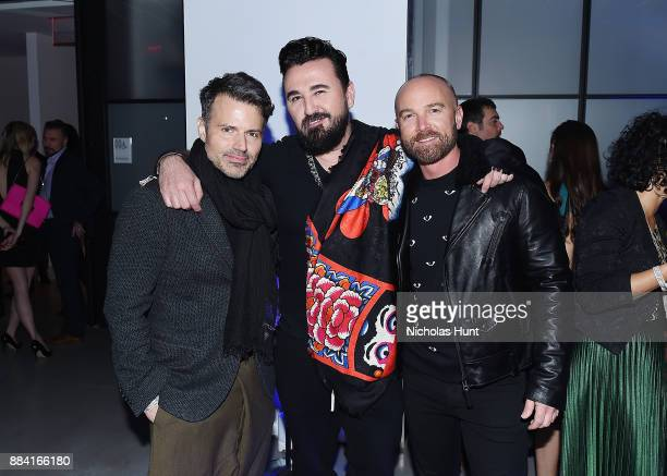Jason Hoffman Chris Salgardo and Chad Richter attends the 2017 amfAR generationCURE Holiday Party on December 1 2017 in New York City