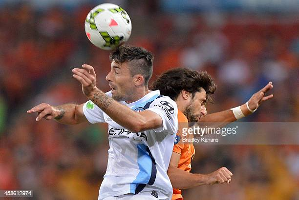 Jason Hoffman of Melbourne City and Thomas Broich of the Roar compete for the ball during the round five ALeague match between the Brisbane Roar and...