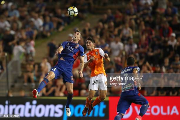 Jason Hoffman of the Jets and Connor O'Toole of the Roar contest a header during the round 16 ALeague match between the Newcastle Jets and the...