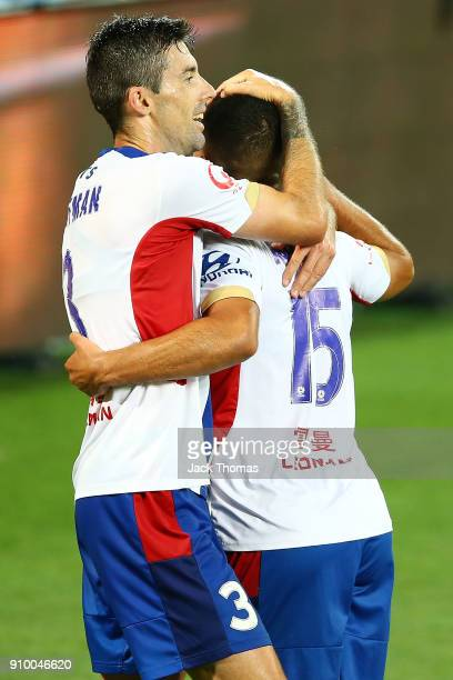 Jason Hoffman of the Jets celebrates a goal with team mate Andrew Nabbot of Newcastle Jets during the round 18 ALeague match between Melbourne City...