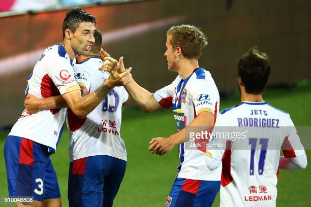 Jason Hoffman of the Jets celebrates a goal with team mates during the round 18 ALeague match between Melbourne City FC and the Newcastle Jets at...